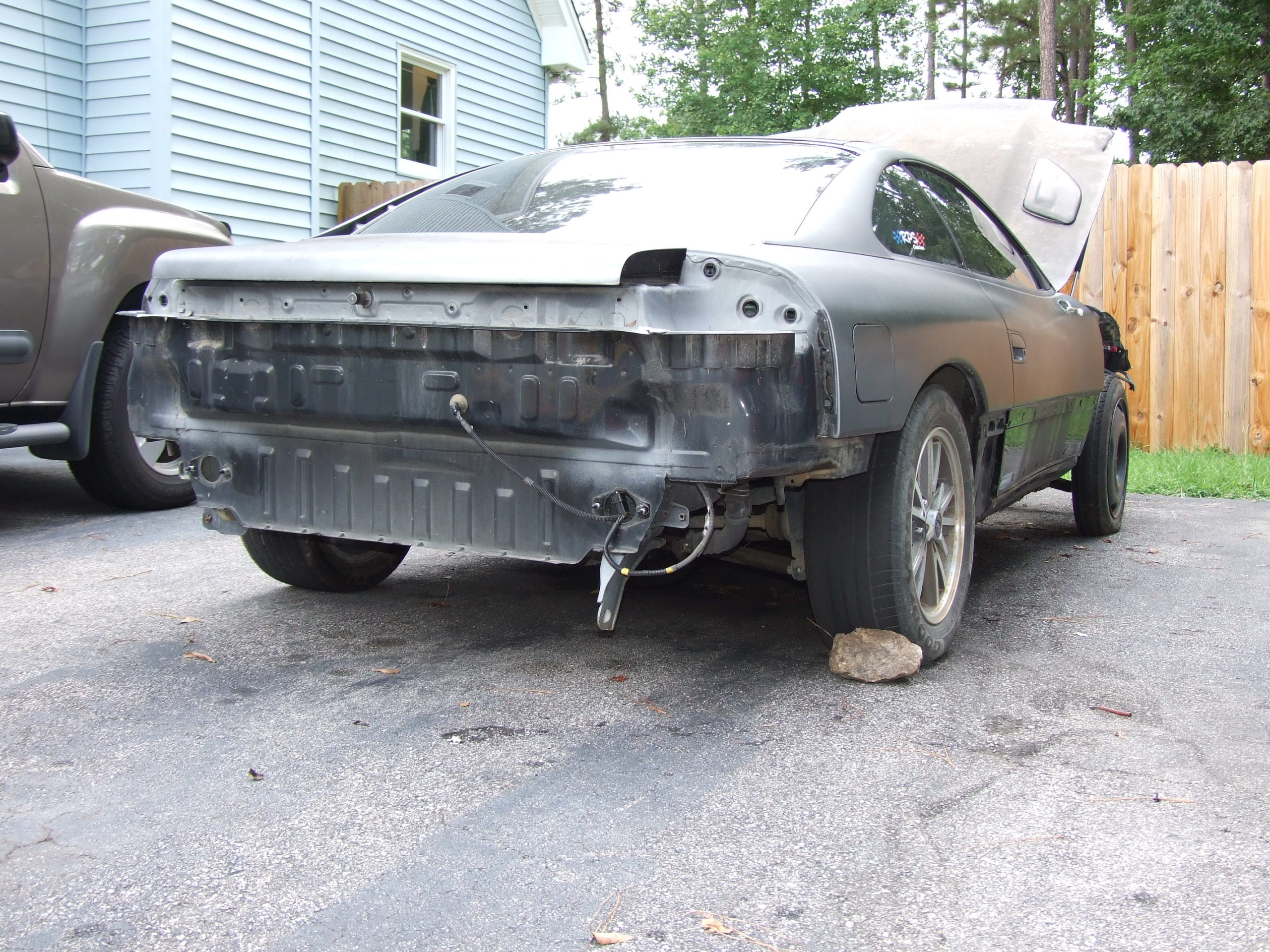No bumpers, sideskirts, fenders, etc. The body was straight for the most part.